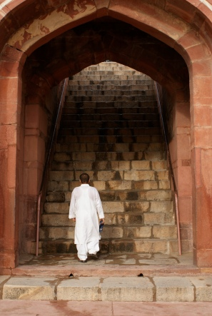 Man walking up stairs in India
