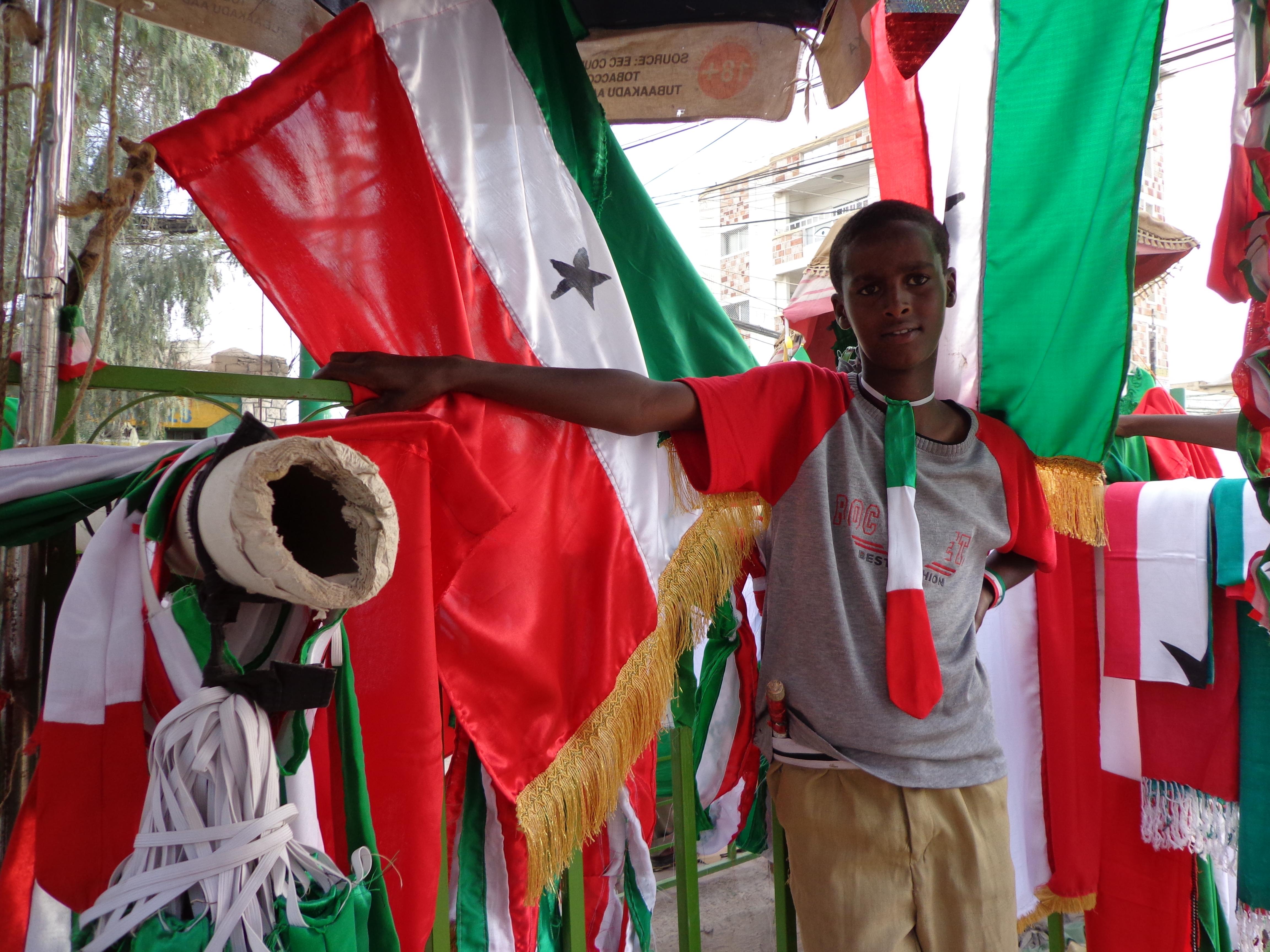Boy selling Somaliland flags