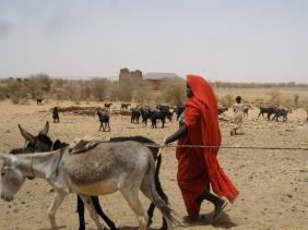 Woman in red in Sudan